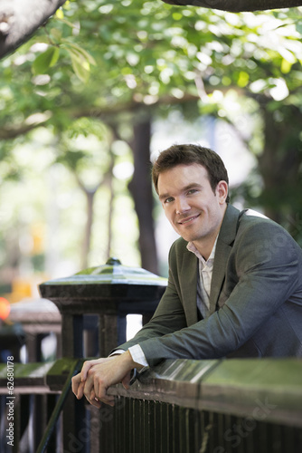 Summer. A Young Man In A Grey Suit.
