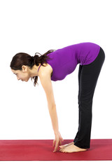 Woman in Standing Half Forward Bend Pose in Yoga