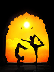 Yoga silhouettes in temple