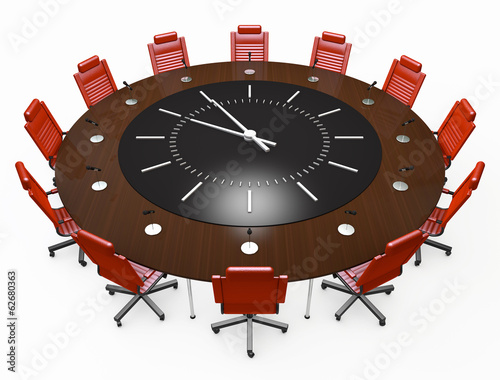 Office chairs and round table with a clock face