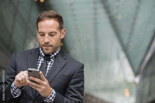 Business People. A Man In A Business Suit. A Man With Short Red Hair And A Beard, Wearing A Suit, On His Phone.
