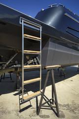 Italy, Fiumicino, luxury yacht ashore, stern ladder