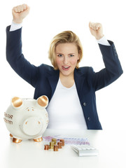 Woman is happy to save money in piggy bank