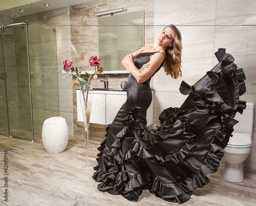 Girl with spanish flamenco dress in a bathroom