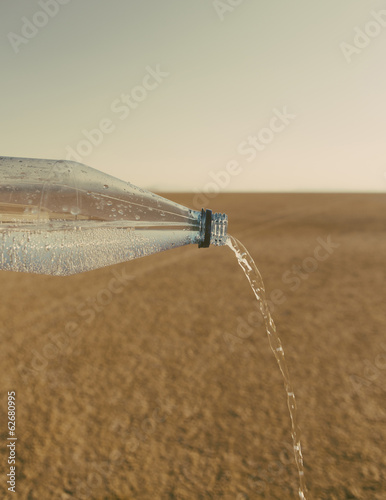 The Landscape Of The Black Rock Desert In Nevada. A Bottle Of Water Being Poured Out. Filtered Mineral Water.
