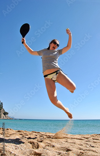 Cheerful woman playing tennis