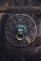 Antique knob on a wooden door, Augsburg, Germany