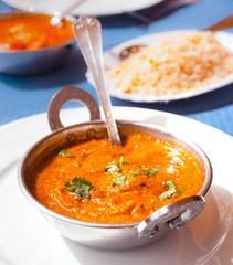metal bowl with stewed lamb tikka sauce