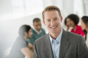 Business Meeting. A Man Smiling Confidently.