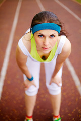 Young woman on running track