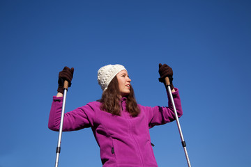 nordic walking: woman with sticks