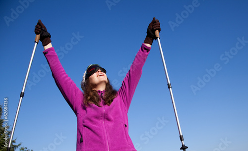 woman with ski sticks enjoying winter