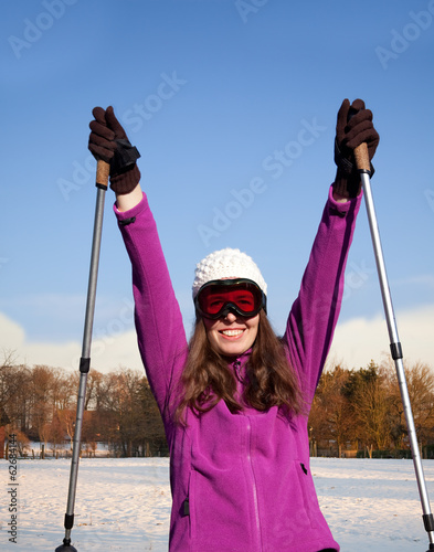 happy woman with ski sticks