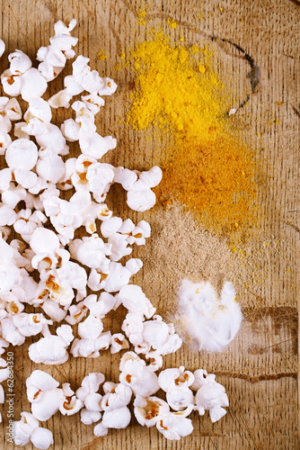 healthy popcorn with defferent type of salt on wooden board
