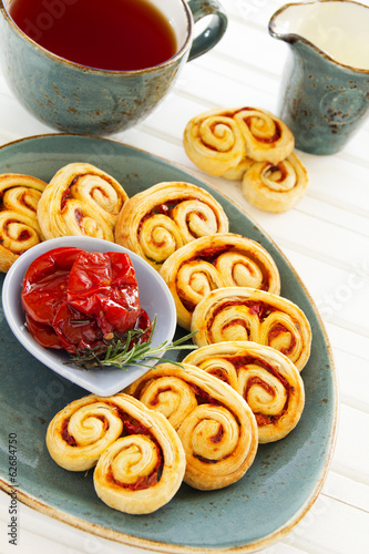 "Puff pastry ""ears"" with sun-dried tomatoes and rosemary."