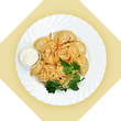 Dish with dumplings on white plate. Isolated image.
