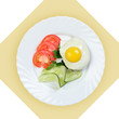 Dish of scrambled egg with vegetables on white plate.