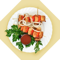 Dish of meat on skewer with tomato sause on white plate.