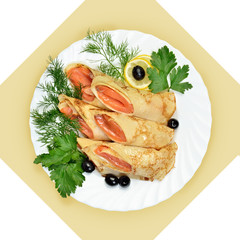Salmon rolls in crepes with greens on white plate.
