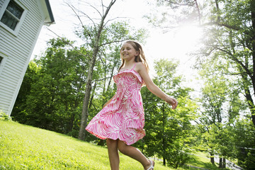 A Young Girl In A Pink Patterned Sundress