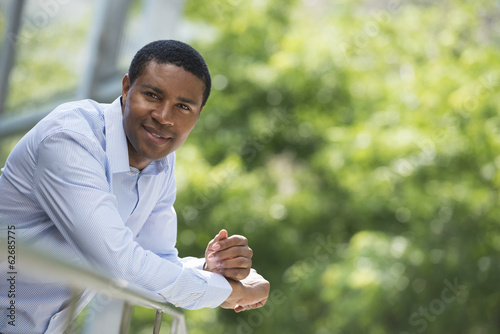 Summer. Business People. A Man Leaning On A Railing Relaxing. Off Grid.