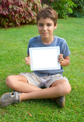 boy showing empty tablet PC