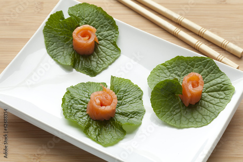 Smoked salmon on wasabi leaves
