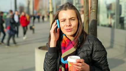 Young woman talking on cellphone in the city
