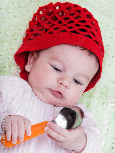 Portrait baby in red bonnet