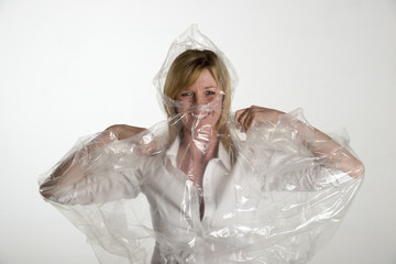 Woman putting on a plastic poncho