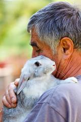 Man with gray rabbit