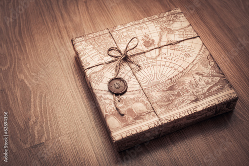beautifully packaged parcel in brown paper and tied with a rope