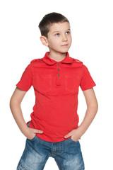 Pensive little boy in a red shirt