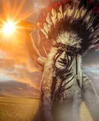 American Indian warrior, chief of the tribe, sunset. man with fe