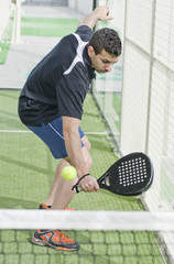 Paddle tennis player ready for backhand