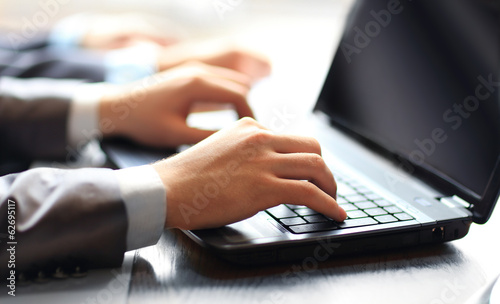 Person team Typing on a modern laptop in office