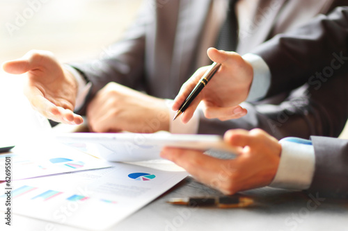 businessmen using touchpad at meeting