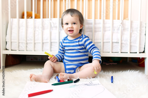 lovely baby with pens