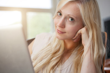 Blond woman with laptop