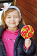 cute little girl with candy