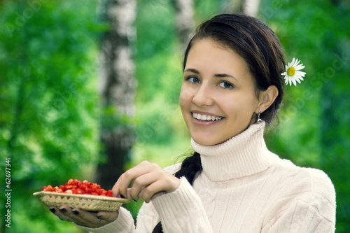 Teenager with forest strawberries.