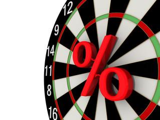 Символ процента в центре доски дартс
