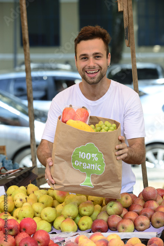 Small business owner selling organic fruits and vegetables.