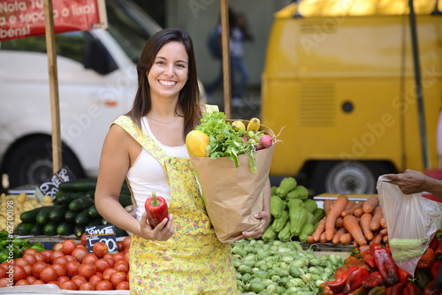 Woman shopping  at open street market.