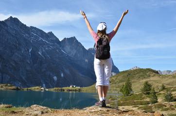 Traveler enjoying alpine view. Switzerland