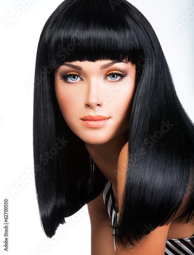 Beautiful brunette woman with long black straight hair