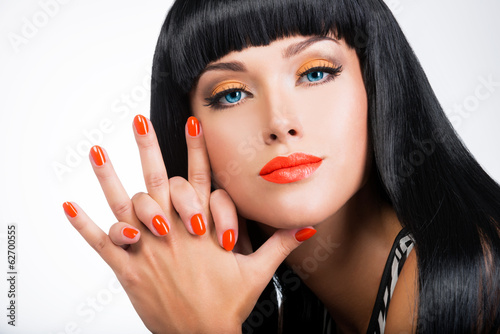 portrait of a woman with red nails and glamour makeup © Valua Vitaly