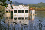 View of old bathhouse in Lake of Banyoles poster