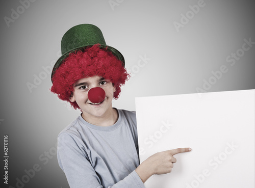 boy with clown nose and hat on background