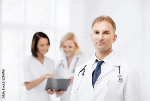 male doctor with colleagues